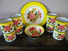 Vintage Set of 24 Enamelware Dishes - 8 PC Setting from Hong Kong. $100.00, via Etsy.