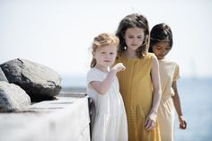 Summer girls by the sea.  Wrap dress in creme coloured double gauze, Sleeveless summer dress in golden checks and striped beach dress in honey/ecru melange rib.