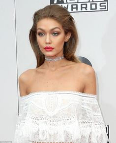 Model behaviour: Adding a little touch of bling to the ensemble was a glittering silver choker which accentuated the blonde beauty's slender neck