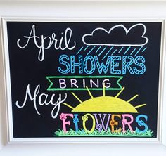 april showers bring may flowers chalkboard. Hand lettering and artwork made with liquid chalk markers on a chalkboard