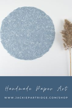 Made with recycled blue jeans this piece of handmade paper art is complete with soft deckled edges. Each artwork is original and handcrafted. Every piece from this limited series is unique as different threads of denim are collected to make the round circle shape. You can choose from dark or light blue paper. The neutral and minimal design is the perfect addition to any room and complements your style with its simplistic design! Click to learn more...