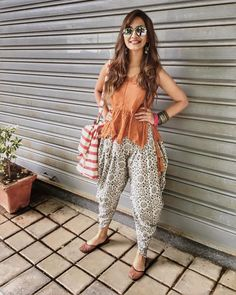 Dhoti pants are high on trend right now as they are comfortable and stylish! Here are 6 different outfit ideas for women to style dhoti pants with. Indian Style Clothes, Dress Indian Style, Indian Attire, Indian Wear, Indian Outfits, Indian Dresses, Stylish Dresses, Trendy Outfits, Fashion Dresses