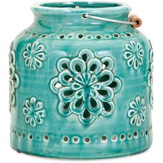 Better not dahlia: We predict this small ceramic lantern in turquoise blue with trend-right lacy, floral cut-outs will disappear quicker than a candle flame on a windy summer evening. - Dimensions: 7.
