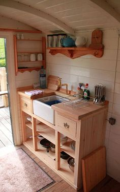 Compact kitchen.  Add a hot plate, and done! I love the light colors and... I do love that deep sink