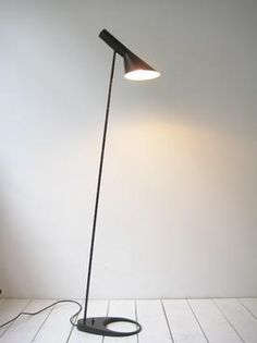 A black floor lamp by AJ by Arne Jacobsen for Louis Poulsen, 1960.