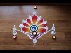 Here is a simple freehand flower rangoli design.It is based on one of my original rangoli designs and I have tried to do some innovation with the placement o. Easy Rangoli Designs Videos, Indian Rangoli Designs, Rangoli Designs Latest, Simple Rangoli Designs Images, Rangoli Designs Flower, Rangoli Border Designs, Rangoli Patterns, Rangoli Ideas, Rangoli Designs With Dots