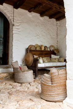 Love this shaded nook with sun hats ready and waiting.