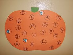 Draw and cut out a pumpking from orange construction paper.  Write  lower case letters on it.  Have the children place the corresponding upper case letter sticker on the pumpkin.