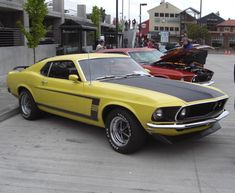 Nice view of a Bright Yellow (Grabber Yellow) 1969 Mustang Boss 302 fastback at the 2010 Mustang Car show in Port Angeles, Washington. 1969 Mustang Fastback, 2010 Mustang, Mustang Boss 302, Mustang Cobra, Ford Mustang Shelby, Ford Mustangs, Shelby Gt500, American Muscle Cars, Bright Yellow