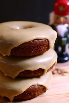 Soft, baked doughnuts full of rich gingerbread flavours! Perfect for the holidays! #vegan