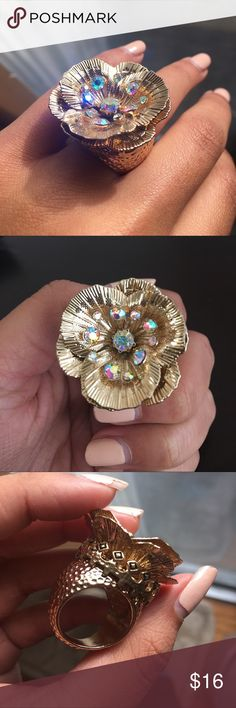 Katy Perry Prism Collection Gold Tone Rose Ring Katy Perry PRISM Collection gold tone metal and rhinestone cluster rose ring. In very good condition, like new, only worn once. Please see photos as they are part of the description. NOT AMERICAN EAGLE!!! Listed for exposure. American Eagle Outfitters Jewelry Rings