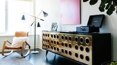Designer Crush: Catherine Kwong // living rooms // brass and lacquered Jean Prouve cabinet, black Crosely record player, Mongolian fur pillow, adjustable arm floor lamp