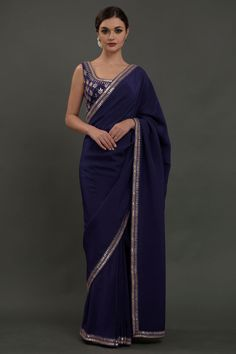 From our Wedding and Bridal Collection, this is a Burgundy pure crepe saree and blouse with intricate exquisite silvery gold gota patti hand embroidery. The embroidered work adorns the saree borders inches wide. The blouse is adorned with al Sari Design, Gota Patti Saree, Bridesmaid Saree, Crepe Saree, Georgette Sarees, Simple Sarees, Simple Saree Designs, Sari Dress, Plain Saree