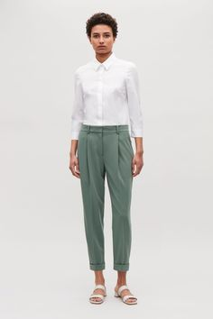 COS image 1 of Drape pleated trousers in Sage