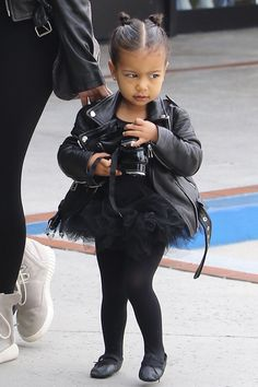 North toughens up her all-black ballet tutu with an edgy leather jacket—and her signature double bun hairstyle.   - HarpersBAZAAR.com