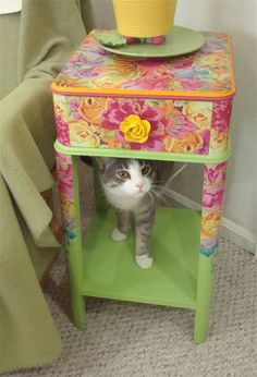 She painted a nightstand and decoupaged it with copies of fabric prints.