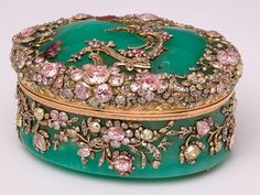 "One of eight green chrysoprase snuffboxes owned by Frederick the Great of Prussia, about 1755 - this one given to his brother Augustus Wilhelm.  From V website: ""design is probably by Jean Guillaume George Kruger, a London trained designer who moved to Berlin in 1753 and designed a series of snuffboxes in the Prussian royal collection...  [These boxes were] set with diamonds, gold & hardstone scrolls, vines and flowers."" The diamonds are backed with pink, green & yellow foil to reflect…"