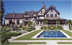 CURB APPEAL – another great example of beautiful design. love the detailed dark wood, the pool, manicured grounds, wrap-around porch, etc.