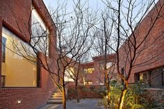 Fortress Brick House / Wise Architecture Combination of all brick facades, courtyard proportions, and accent lighting - feels like a cozy outdoor nook for autumn.