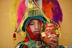"GUATEMALA, QUICHE : An indigenous child dressed for the Dance of the  Conquerors poses during the annual fair in honor of the ""Virgen del  Transito"" (Transit Virgin), in Joyabaj municipality, Quiche departament,  220 km northwest of Guatemala City on August 8, 2015. Hundreds of  indigenous people celebrated Saturday a fair in honour of the patron  saint of Joyabaj with ancestral Maya dances representing the fight  between good and evil. AFP PHOTO/Johan ORDONEZ                    ..."