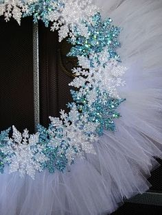 Wreath... Dollar store snow flakes and wreath form, and tulle from the fabric store.