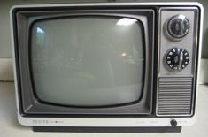 black and white TV...with knobs...and special remotes that doubled as children