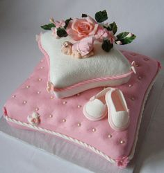 Pillow Christening Cake with a sleeping baby girl and a flower arrangement