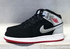 Jordan 1 mid GS in black and silver.