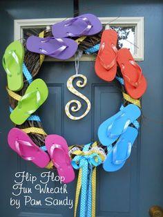 Flip Flop Wreath by Pam Sandy. 7 Home Decor Ideas with Flip Flops: http://www.completely-coastal.com/2013/05/flip-flop-crafts-decorations-home.html