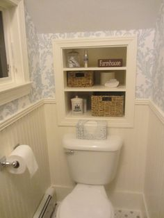 Downstairs 1/2 bath under the stairs - use built in storage to save space.