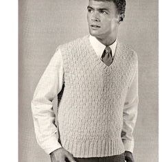 Free Mans Knitting Pattern for pullover vest, sleeveless sweater, for the man in your life.  This attractive vest might even be something he'll wear!  This is a Free Download.