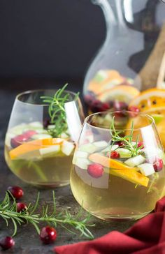 Pinot grigio with cranberries orange slices fruits and herbs is the absolute perfect holiday sangria! Holiday Sangria, Winter Sangria, Holiday Punch, Winter Holiday, Christmas Holiday, Christmas Ideas, Champagne Sangria, Cranberry Juice Cocktail, Cocktail Drinks