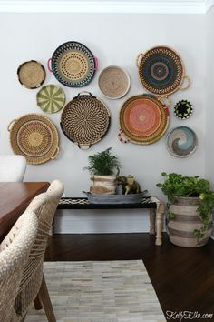 Basket Gallery Wall - love this colorful, eclectic, hand woven African basket wall all from HomeGoods and her unique way to hang them! kellyelko.com sponsored pin #gallerywall #basket #wallart #boho