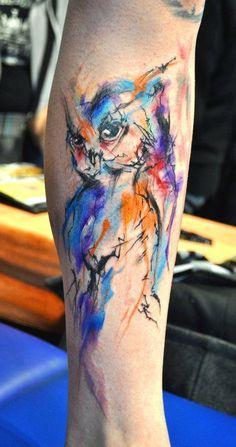 Incredible watercolor owl tattoo