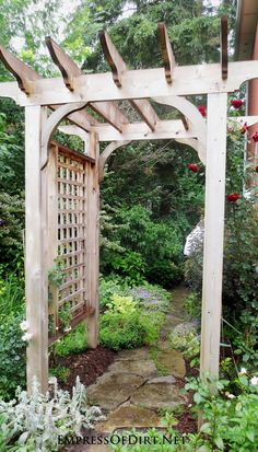 Wood arbor with garden path - see 20+ arbor, trellis, and obelisk ideas for your garden