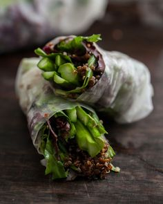 Fresh spring rolls filled with Mediterranean flavor - a great fusion of east and west! We especially love the use of protein-packed red quinoa. | Grilled Asparagus and Chili Orange Quinoa Spring Rolls, recipe by Naturally Ella