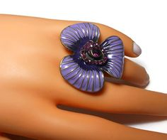 Use code SOCIAL15 for 15% off all purchases over $15, plus FREE shipping on most jewelry! Large flower cocktail ring, purple enamel petals with gold veins and a amethyst rhinestone center surrounded by pave rhinestones, stretch. The base size is a large 7.   Per... #etsygifts #vintage #vjse2 #jewelry #gift