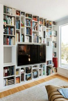 32 Stunning Bookshelf Design Ideas For A Minimalist Home That You Should Try - Bookshelf furniture pieces are very interesting. Their main function, to store and keep books, is a simple yet very important one. Most people think t. Cozy Home Library, Home Library Design, Family Room Design, Bookshelves In Living Room, Living Room Tv, Tv Bookcase, Small Home Libraries, Snug Room, Bookshelf Design