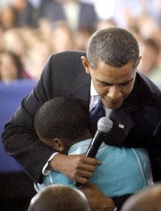 hugging a student in New Orleans in 2009...