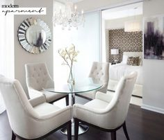 Everything here speaks to an elegant style, from the ceiling chandelier (an old accessory used well) to the tufted dining chairs.