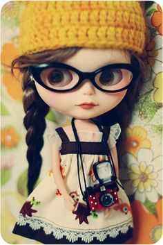 Glasses AND a camera! If only she had shorter hair!(she'd still be far too cute to be me! haha)