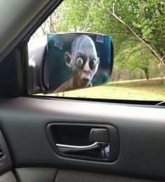 Precious, character, Lord of the Rings Movie, looking in car auto truck side mirror or rear view mirror,  One of the best pranks I think I have ever pulled at work! Score!