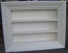 picture frame + utensil tray = perfume, nail polish, mini pic wall display.