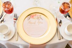 Loving how the couple incorporated their colors of gold and peach into the place setting! Captured by Kylie Crump Photography #bridesofnorthtx #wedding #placesetting