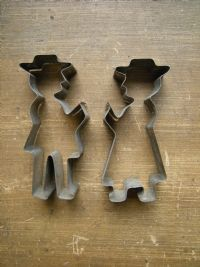 """A set of small (3"""") antique Pennsylvania Dutch cookie cutters of an Amish man and woman - notice the hats that both of them are wearing!"""