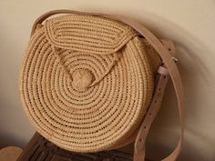 straw circular bag, rafia bag,summer tote,round basket bag,round shoulder bag,rattan round bag,raffia bag,ata bag  The round Raffia shoulder bag is an unique handwoven bag with leather handle in Marrakech, Morocco  it is in Raffia, from real palm, not simple straw. With leather strap  This is a perfect boho chic bag for everyday A must-have of this moment !  Size :  Diameter :27 cm (10,6)  *** As each bag is individually hand crafted, no two bags are identical, they may change slightly in…
