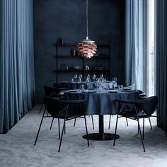 Visiting Paris? Stop by Copenhagen restaurant at La Maison du Danemark on Avenue des Champs-Élysées. Designed by GamFratesi, the interior is rich, dark and intimate. I'm loving the copper PH Artichoke pendant lamp that contrasts beautifully with the blue palette  Photo: Heidi Lerkenfeldt