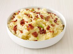 Bacon-Cheddar Mashed Potatoes : Few combinations are as satisfying as bacon, cheddar and mashed potatoes. Food Network Magazine brings them together in a comforting side that's sure to please everyone at the table.