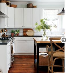 black + white kitchen with butcher block counter & wood floors