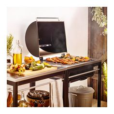 IKEA - KLASEN, Charcoal grill with cart, stainless steel, , With KLASEN charcoal grill and KLASEN utility cart you get a cooking area combined with a practical area to put both serving plates and barbeque accessories.The stainless steel shelf has a durabl Chariot Ikea, Powder Coating Wheels, Ikea Outdoor, Outdoor Living, Grill Area, Bbq Area, Ikea Family, Utility Cart, Outdoor Kitchens